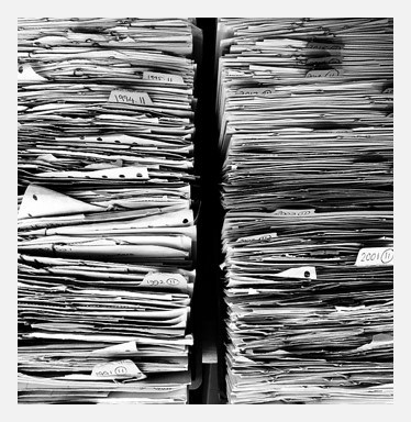 Two stacks of paper forms