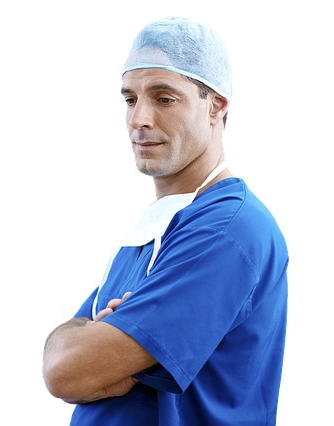 Male doctor in operating clothes with arms crossed
