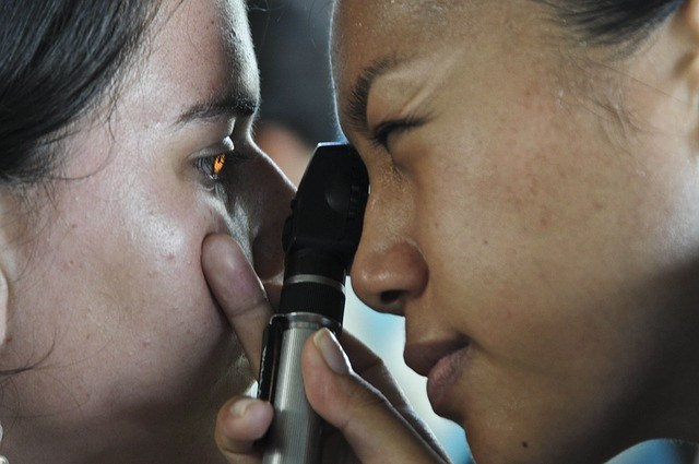 Doctor looking in patients eye