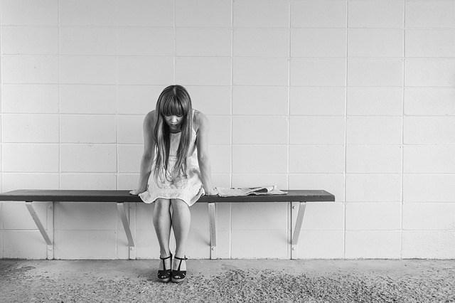Worried girl sitting